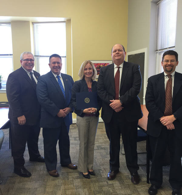 Cathy O'Keeffe receiving FBI award for work to prevent human trafficking